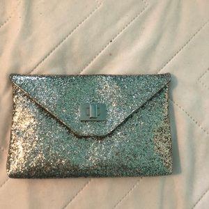 Silver sparkly clutch bag